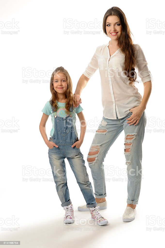 mom stands near his daughter two women smiling stock photo more pictures of 20 24 years istock. Black Bedroom Furniture Sets. Home Design Ideas