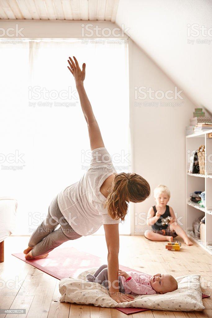 Mom sure likes yoga stock photo