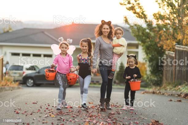 Mom takes a group of kids trick or treating picture id1169655344?b=1&k=6&m=1169655344&s=612x612&h=9hgdou6cvigfcvc gh0zaiqadqyajatsguq sem5jaq=