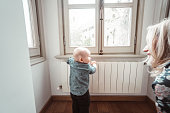 istock mom talking with his kid at home 1152354738