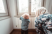 istock mom talking with his kid at home 1152354764