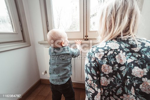 1063760138 istock photo mom talking with his kid at home 1152354797