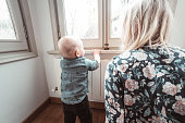 istock mom talking with his kid at home 1152354797