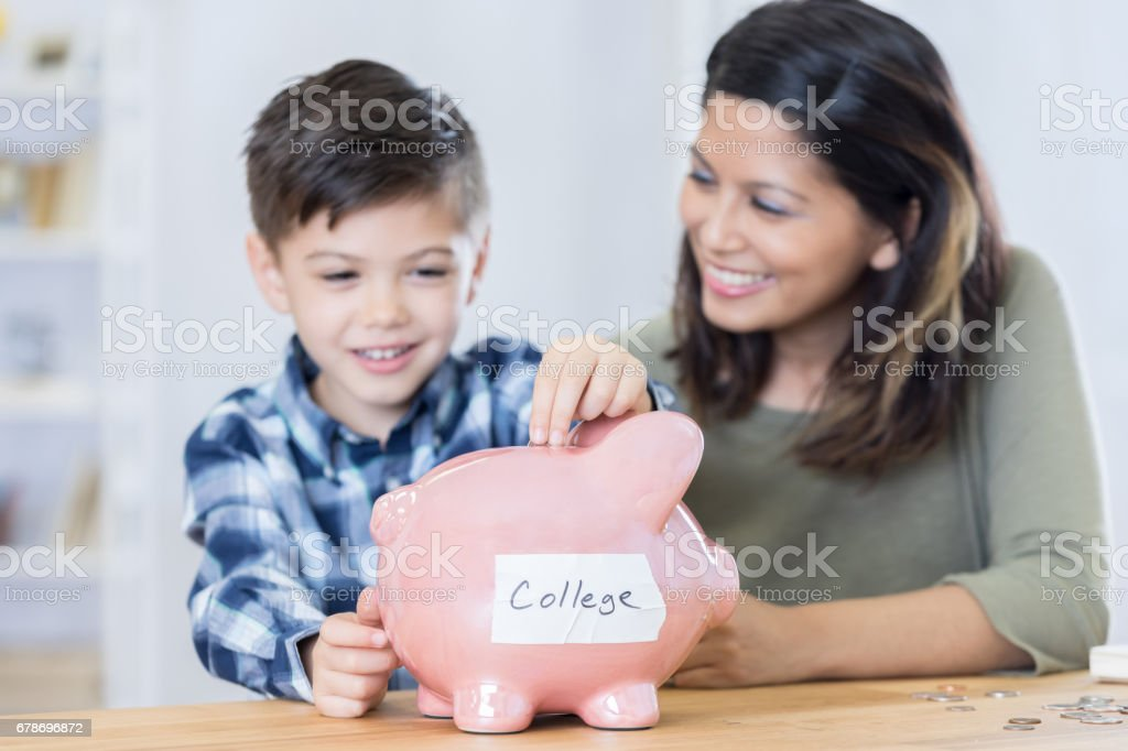 Mom Teaches Her Son About Saving For Colelge Royalty Free Stock Photo