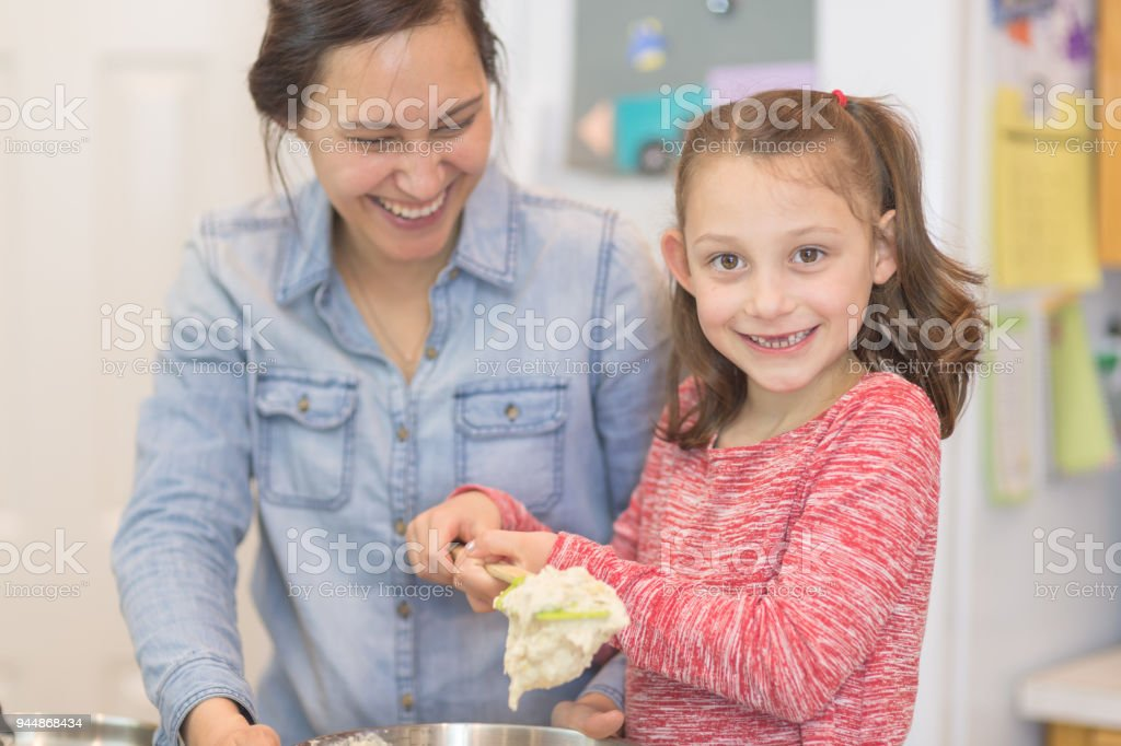 Mom Teaches Her Young Daughter How To Bake Royalty Free Stock Photo