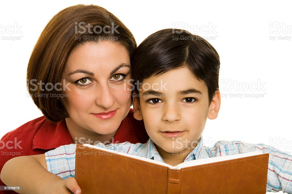 Mom teaching her son royalty-free stock photo