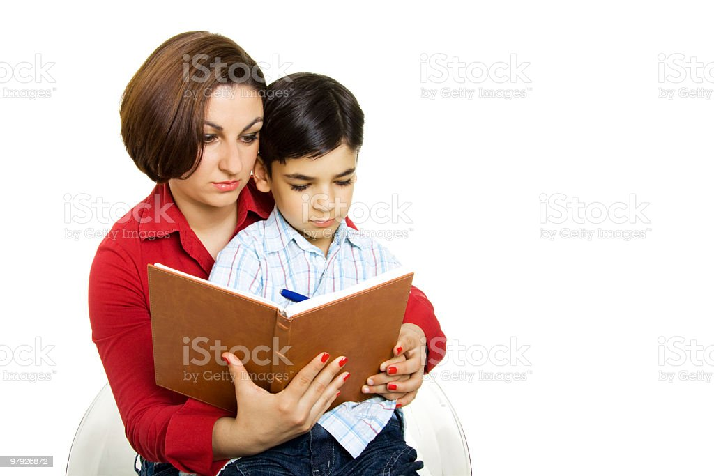 Mom teaching son royalty-free stock photo