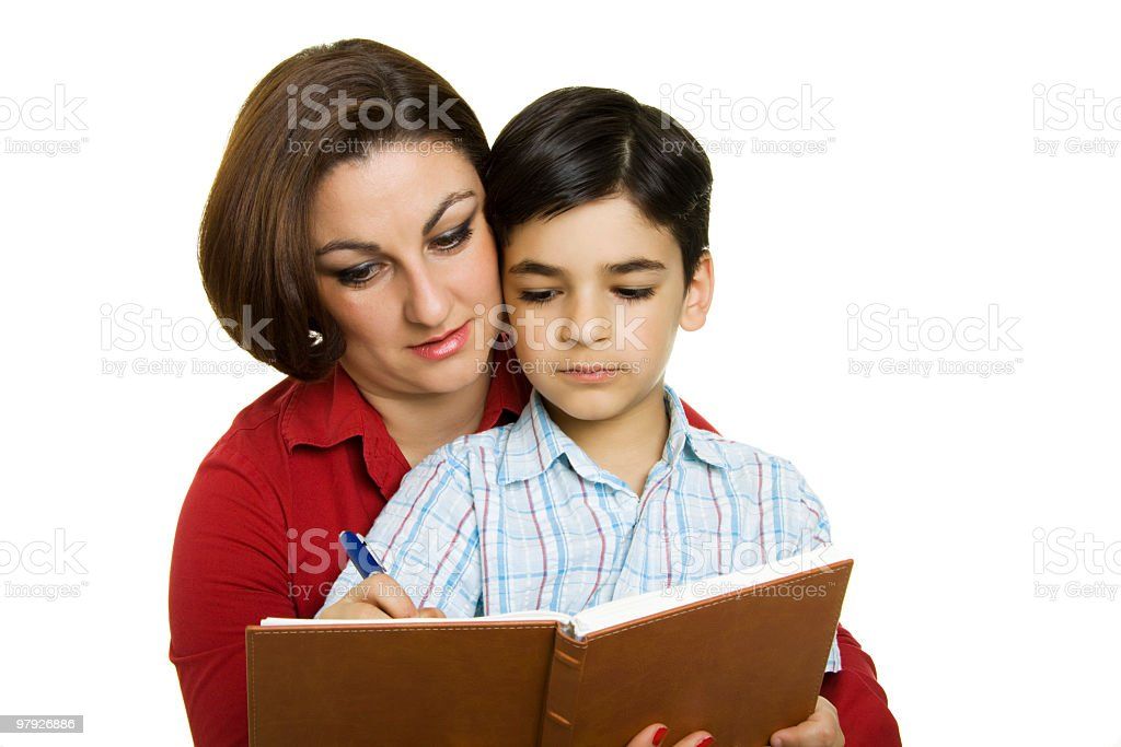 Mom teaching son royalty-free stock photo