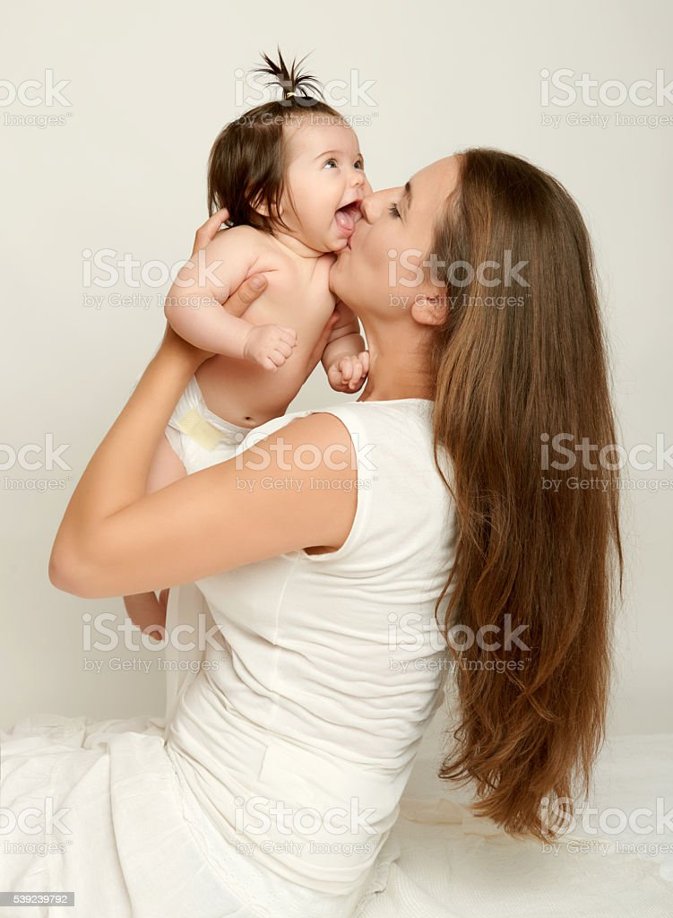 Mom throws up baby and kiss, play and having fun royalty-free stock photo
