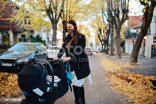 istock Mom walking around the hood with her baby during the covid-19 pandemic 1287289286