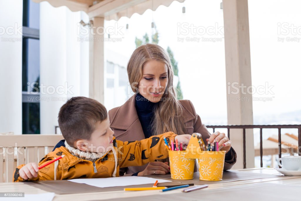 Mom With Boy Draw Colored Pencils Royalty Free Stock Photo