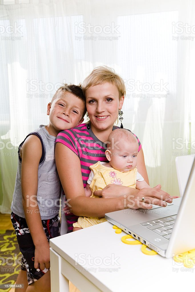 Mom with children using laptop royalty-free stock photo