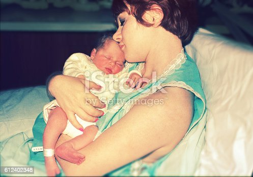 New mom with her newborn baby - original photographic slide form the seventies