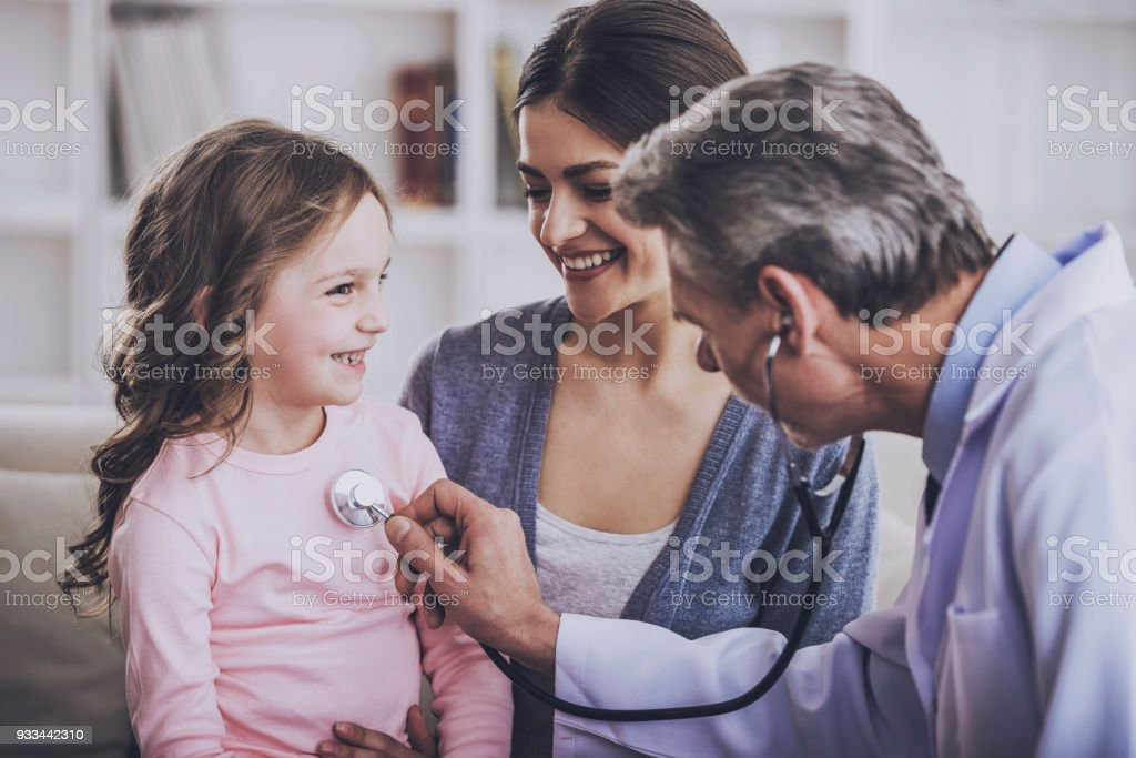 Mom with kid at the doctor. stock photo