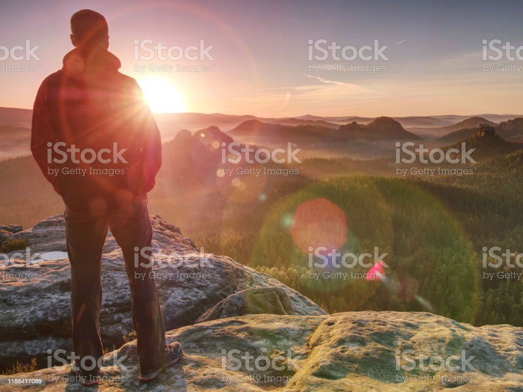 Moment of loneliness. Sportsman with hands in pockets stand on the...