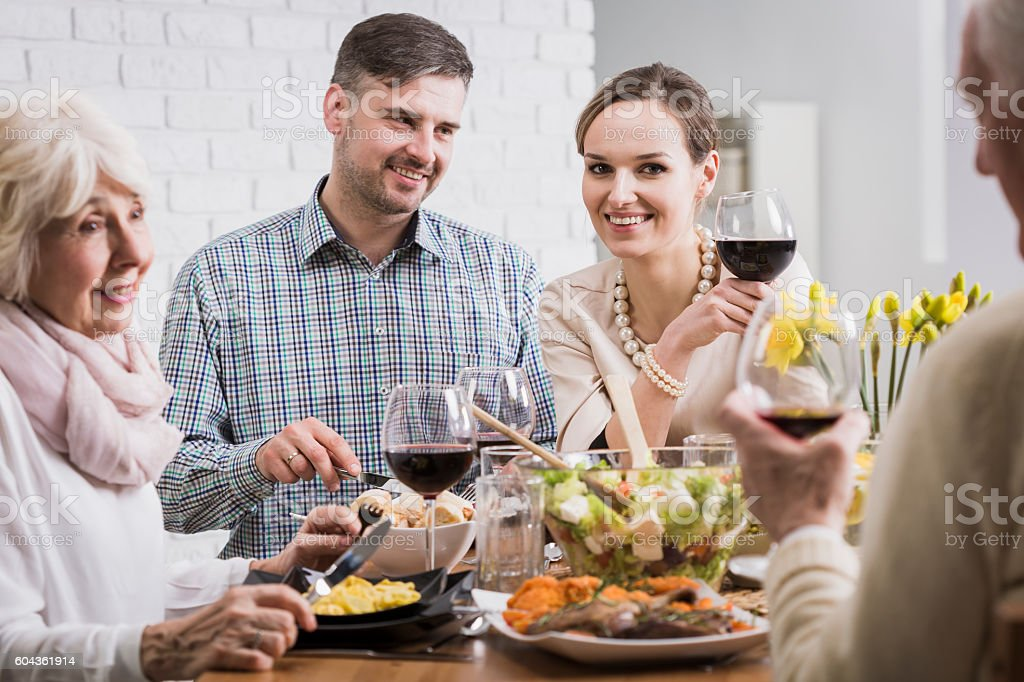 Moment of relaxation at the common meal stock photo