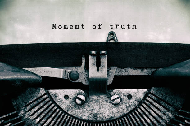 Moment of truth Moment of truth text typed on a vintage typewriter in black and white. dignity stock pictures, royalty-free photos & images