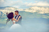 embracing bride and groom in idyllic nature, loving and sharing feelings.windy nature, flying hair.