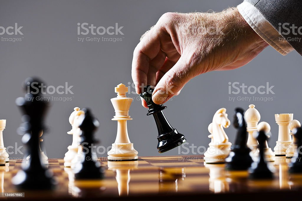 Moments before checkmate in game of chess stock photo