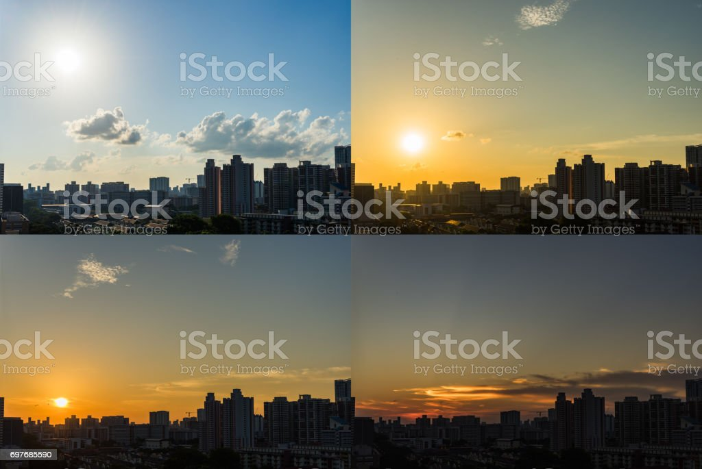4 Moments of Sunset Downtown Singapore skyline day to night stock photo