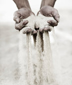 istock Moments slip through his hands like grains of sand... 173668236
