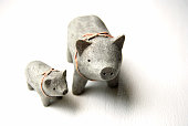 Ceramic pink ribboned momma pig and piglet.