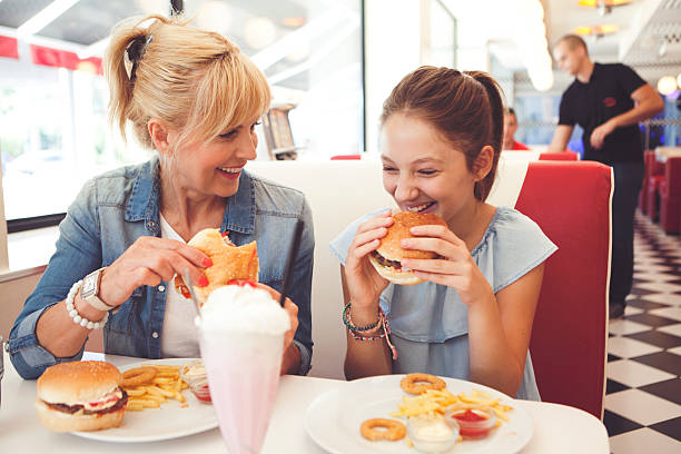 mommy doesn't cook today - fast food restaurant stock pictures, royalty-free photos & images