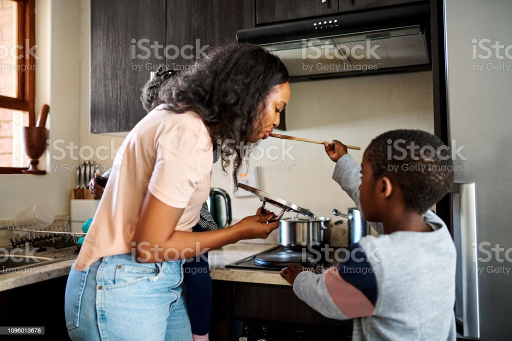 Mommy gets the first taste stock photo