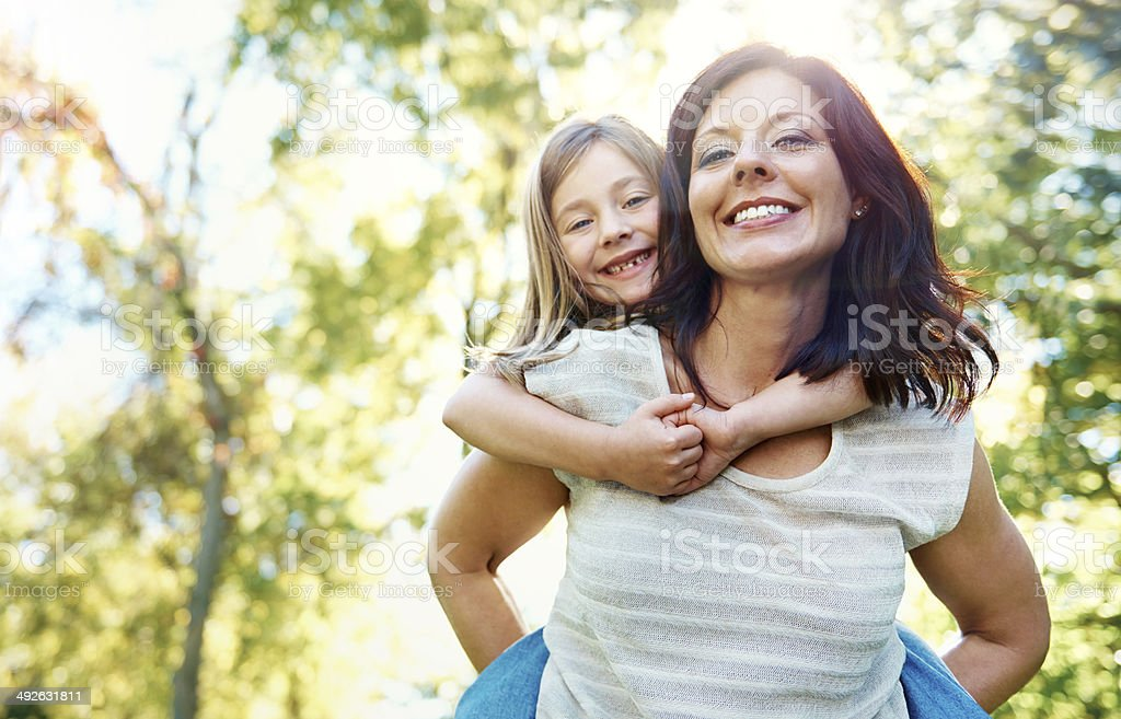 Mommy keeping her safe through the woods stock photo