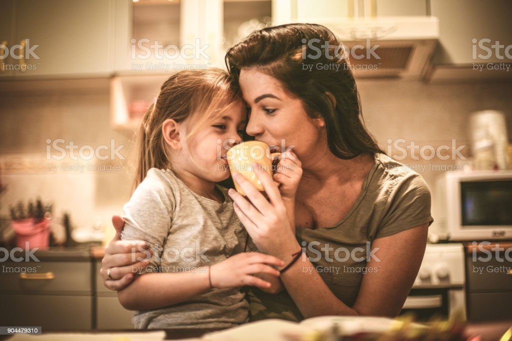 Mommy let me try coffee. Little girl. stock photo