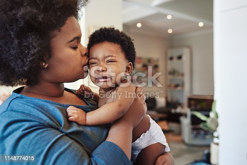 Shot of an adorable baby girl bonding with her mother at home