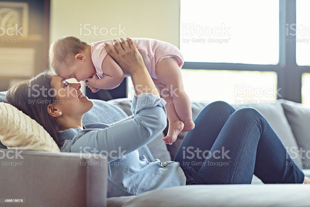 Mommy's got you! stock photo