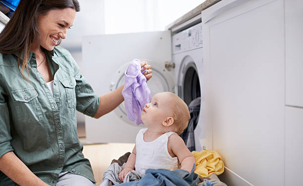 mommy's little helper - laundry laundry room stock pictures, royalty-free photos & images