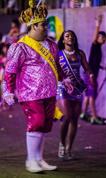 momo king walking with his queen in a carnival parade stock photo