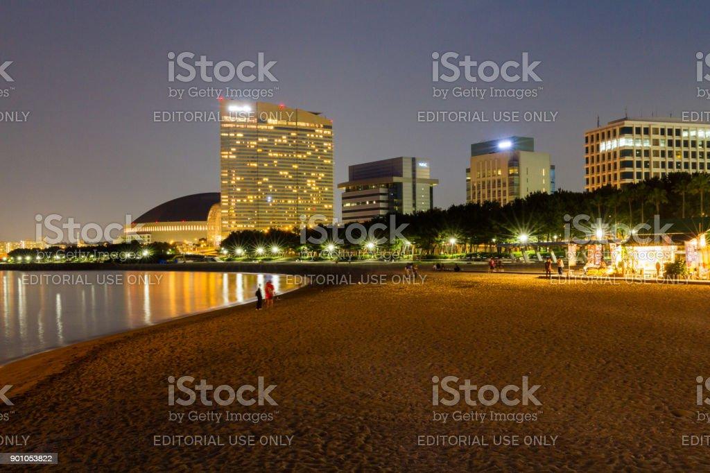 Momochi Beach at Night with Hilton Seahawk stock photo