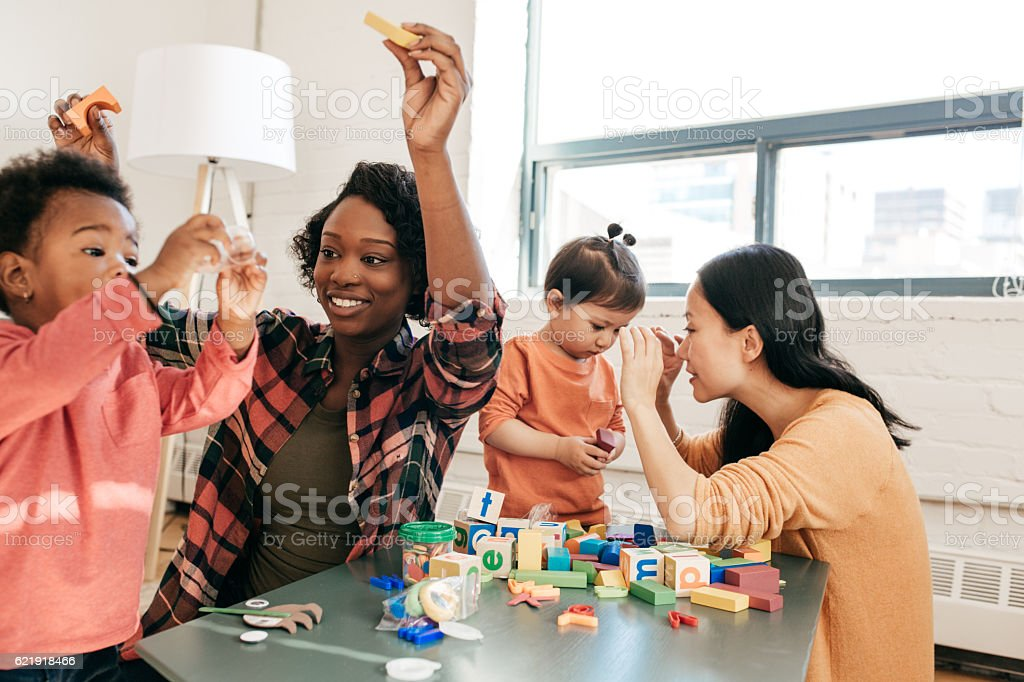 Moms and toddler playdate stock photo