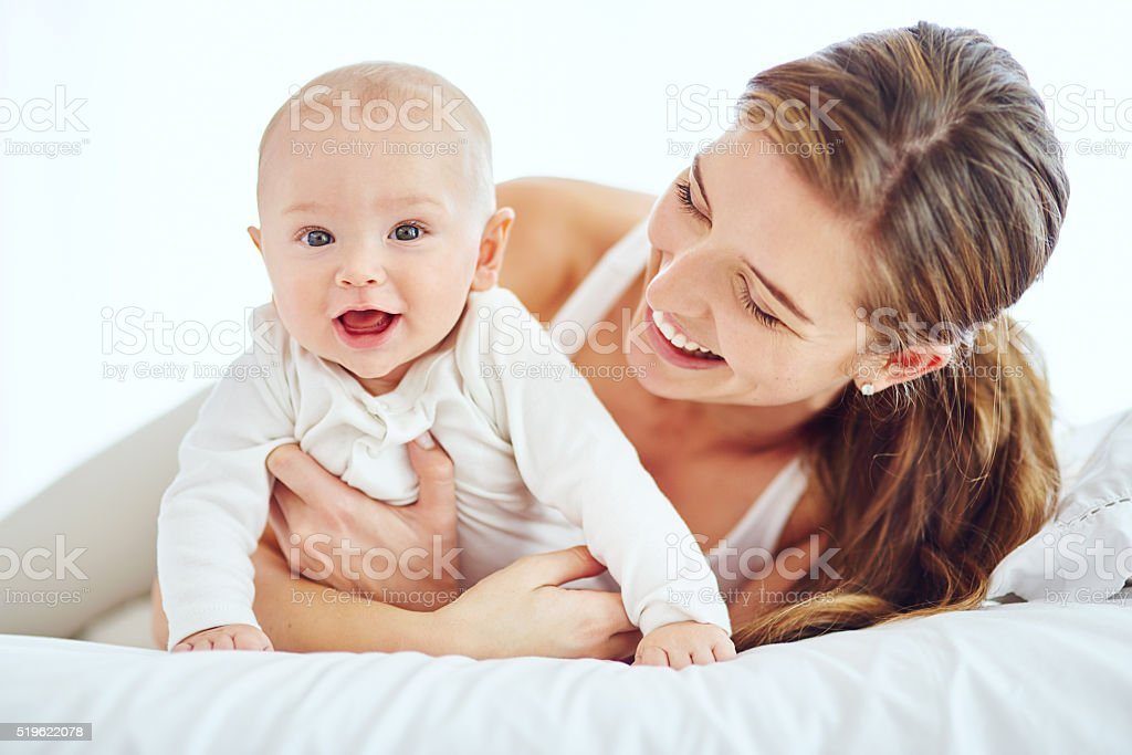 Mom's cuddles are best of all stock photo