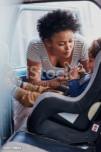istock Mom's got to make sure you're firmly strapped in 1022179944