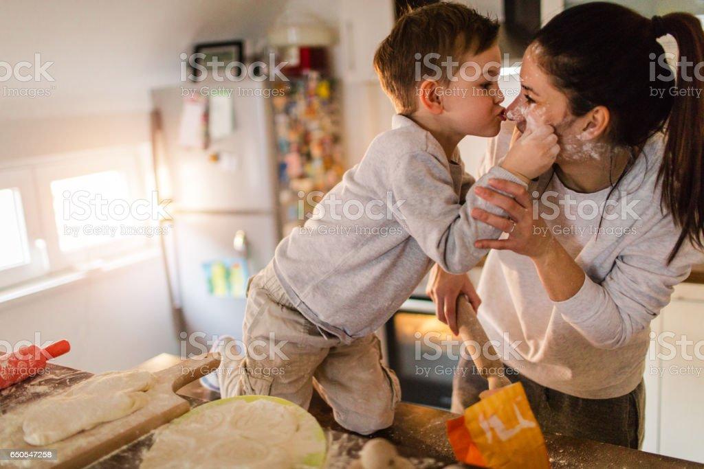 Mom's little baker stock photo
