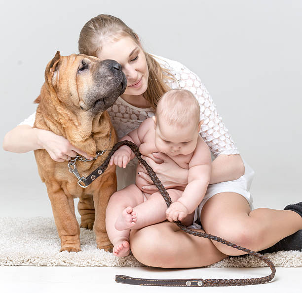 mom's love - naked women with animals stock photos and pictures