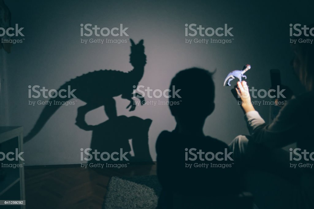 Mom's shadow puppet show stock photo