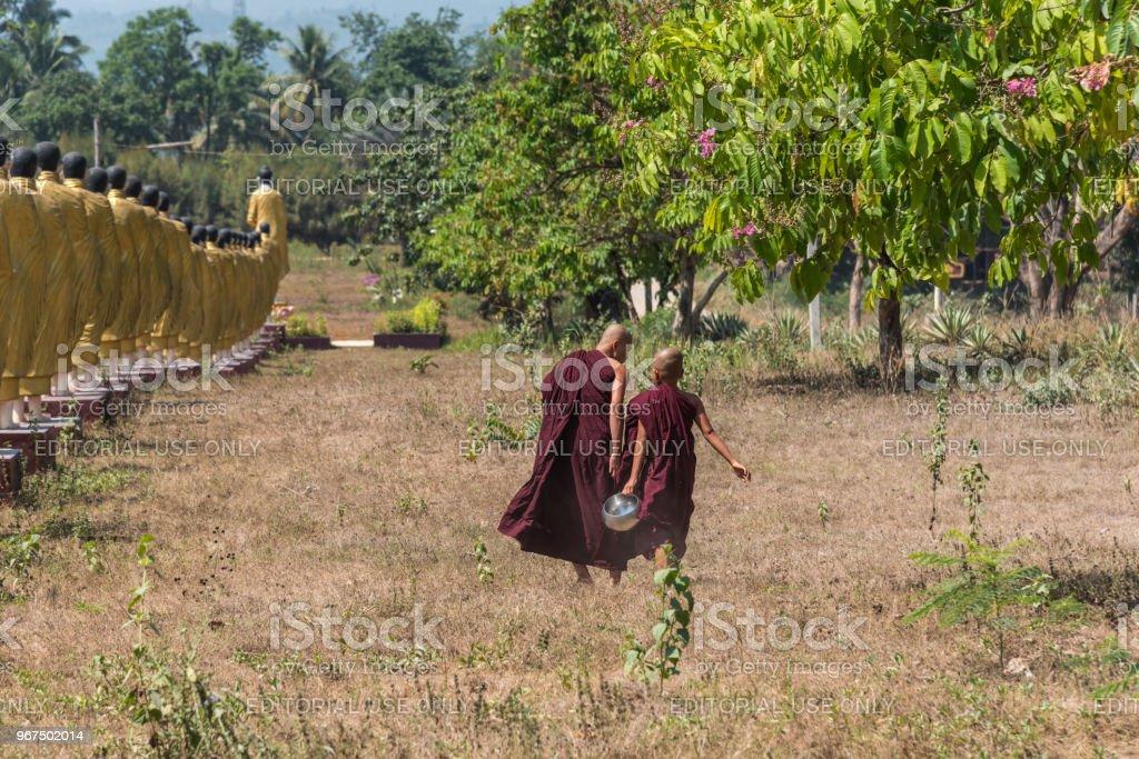 Mon novice runing at Wat Sao Roi Ton Temple stock photo