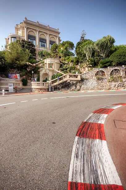 Monaco Grand Prix and Casino Monte Carlo, Monaco - October 4, 2009: The Grand Casino in Monte Carlo seen behind the famous hairpin turn of Virage Rascasse leading on to the uphill section of the Monaco Grand Prix route. Monaco has hosted the prestigious Formula One Monaco Grand Prix every year since 1929, with exception of 1938 - 1947. davelongmedia stock pictures, royalty-free photos & images