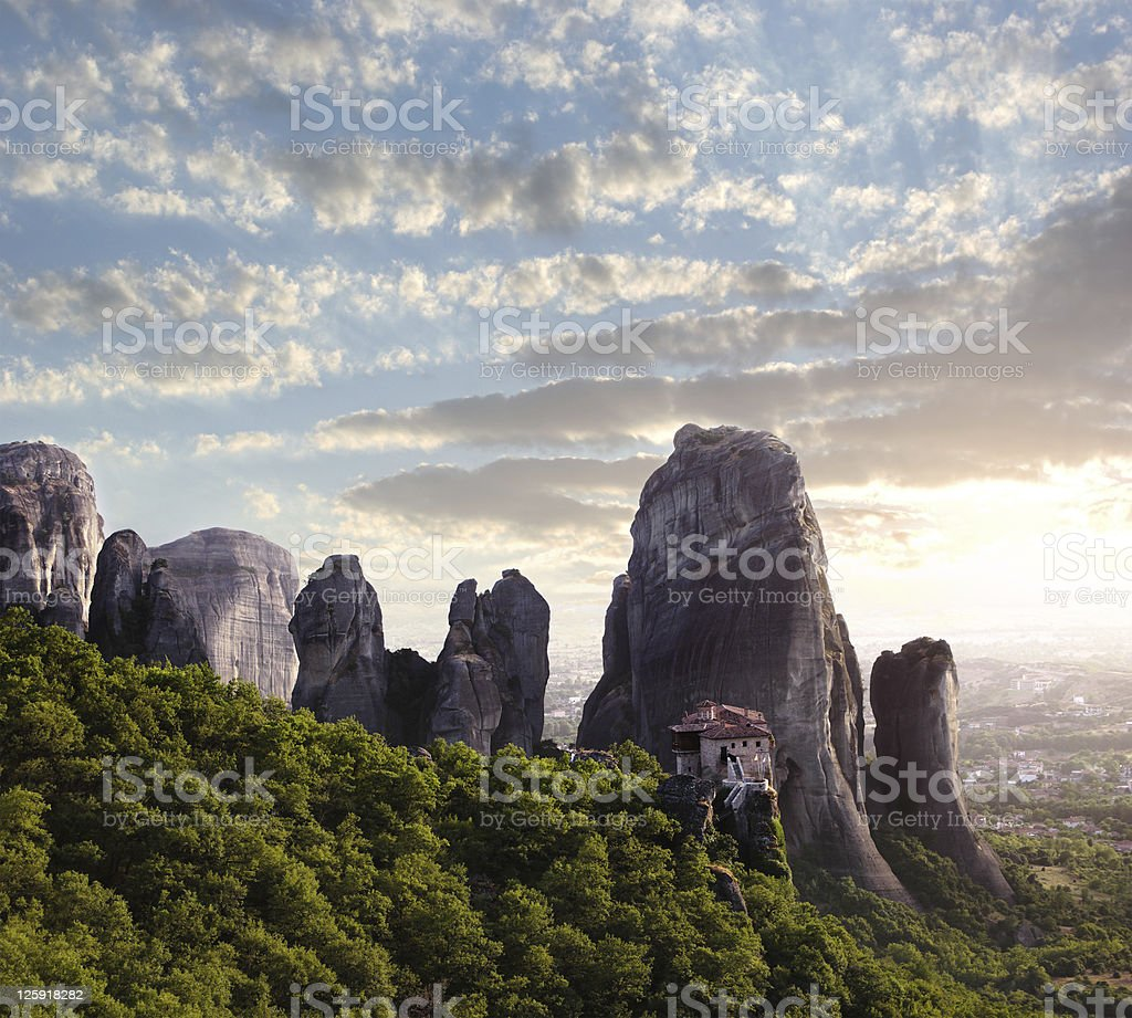 monastery and rocks of Meteora at dusk stock photo