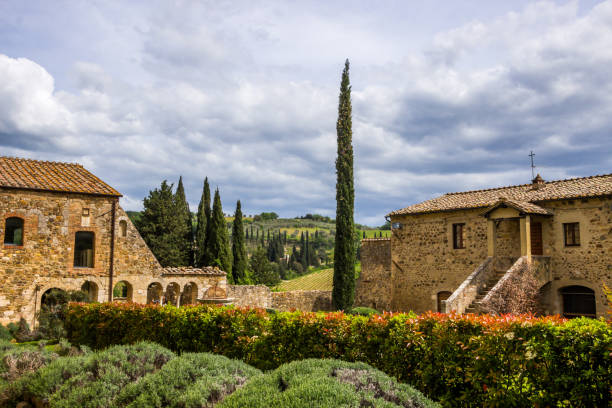 Monastery in Tuscany lonely medieval monastery in the Tuscan hills pienza stock pictures, royalty-free photos & images