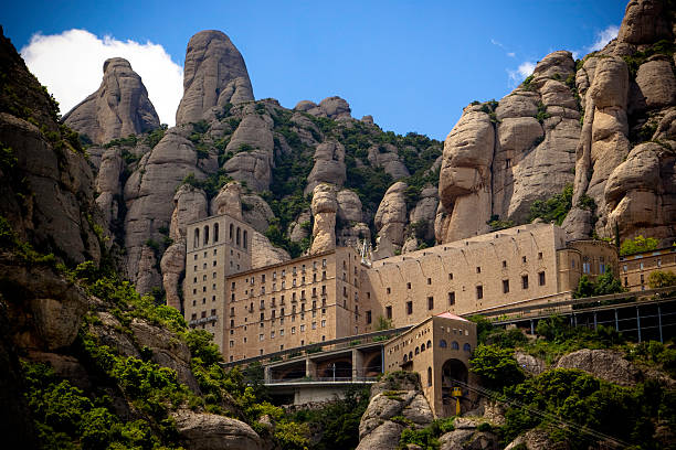 Monastery Montserrat, Barcelona, Spain Benedictine Monastery of Montserrat located high in the mountains near Barcelona. abbey monastery stock pictures, royalty-free photos & images