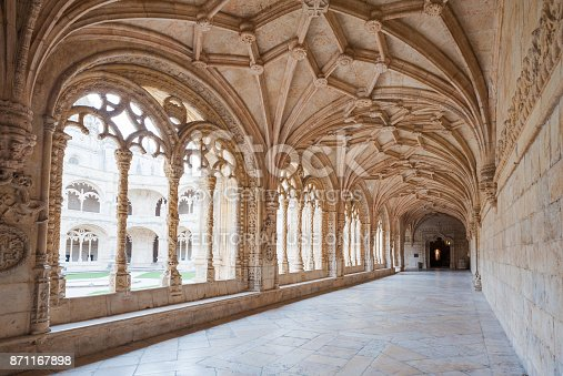 Lisbon, Portugal - Nov 21, 2013 : Monastery of Jeronimos corridor with architecture and sculpture details.