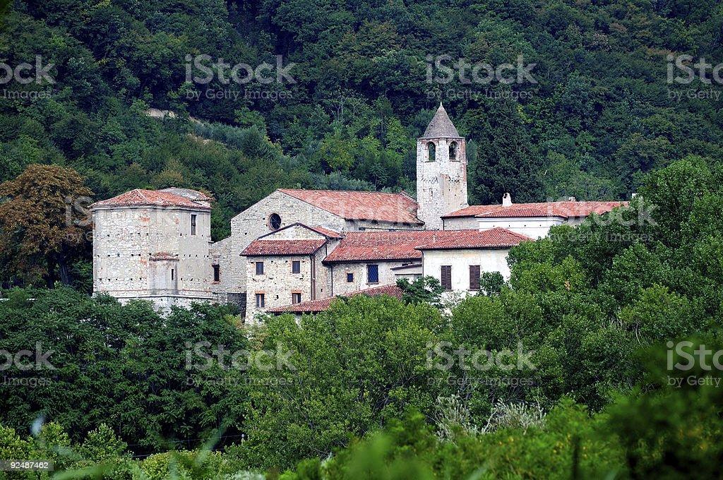 monastery of San Pietro in Lamosa, emerges from lush vegetation royalty-free stock photo