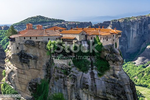 The monasteries in The great Meteors are built on high cliffs surrounded by young oak forest.