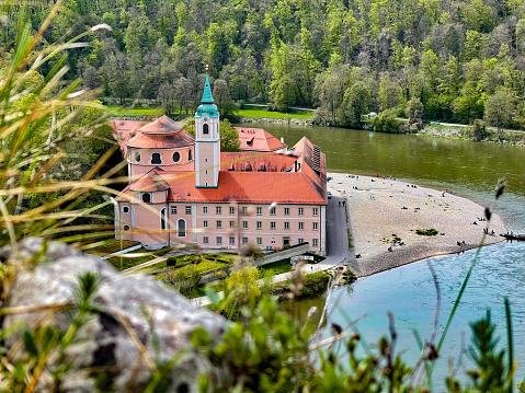 View towards the monastery of Weltenburg at Kelheim in bavarian landscape.